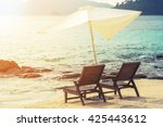 Beach Chairs With Parasol On...