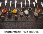 spices and seasoning in spoons... | Shutterstock . vector #425481046