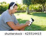 young man relaxing with a... | Shutterstock . vector #425514415