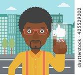 an african american man...   Shutterstock .eps vector #425529202