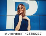 happy smiling girl in a blue... | Shutterstock . vector #425580232