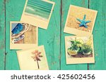 Small photo of top view of instant photos album on wooden blue background. vintage filtered image