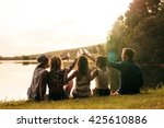group of young people sitting... | Shutterstock . vector #425610886