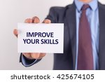 man showing paper with improve... | Shutterstock . vector #425674105