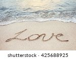 Love Word Handwritten On A...