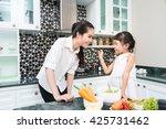happy family preparing... | Shutterstock . vector #425731462