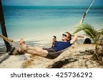 A Young Man Relaxes In A...