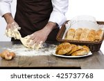 hands knead the dough for... | Shutterstock . vector #425737768