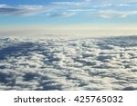 view above the clouds from an... | Shutterstock . vector #425765032