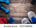 sport stuff on wooden table ... | Shutterstock . vector #425768806