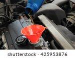 refill of oil  engine of an... | Shutterstock . vector #425953876
