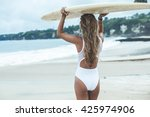 beautiful female surfer looking ... | Shutterstock . vector #425974906