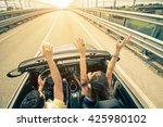 happy couple driving on the... | Shutterstock . vector #425980102