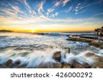 Small photo of Sunrise at Bronte Beach south side near Bronte baths. East Sydney. Waves surge forth.