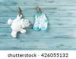 white toy bear and baby socks... | Shutterstock . vector #426055132