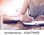 woman hand and silver pen  | Shutterstock . vector #426079405