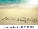 the inscription on the sand... | Shutterstock . vector #426112702
