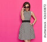 elegant young woman in striped...   Shutterstock . vector #426143872