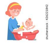 Caring Smiling Mother Washing...