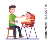 father feeding his baby son... | Shutterstock .eps vector #426222778