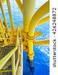 Small photo of Ladder on Aligned Oil and Gas Pipeline and Production slots on the sea background in Offshore wellhead remote platform, Energy and petroleum industry. (Vertical)