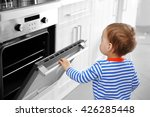 little child playing with oven... | Shutterstock . vector #426285448