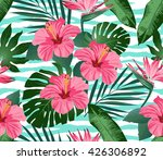 tropical flowers and leaves on... | Shutterstock .eps vector #426306892