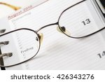 date seen through glasses | Shutterstock . vector #426343276