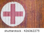Red Cross On Wooden Plate