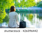 back view of woman sitting in... | Shutterstock . vector #426396442