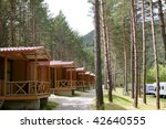 Forest Wooden Cabins In A...