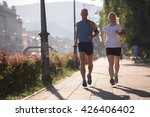 healthy mature couple jogging... | Shutterstock . vector #426406402