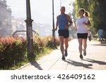 healthy mature couple jogging... | Shutterstock . vector #426409162