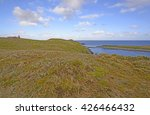 lighthouse and grassland at the ... | Shutterstock . vector #426466432