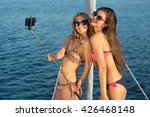 girls with selfie stick smiling.... | Shutterstock . vector #426468148
