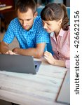 young man and woman with laptop | Shutterstock . vector #426622156