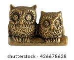 Stock photo brass statuette the pair of owls isolated on white background 426678628