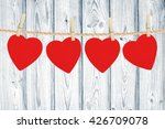 love hearts hanging on rope... | Shutterstock . vector #426709078