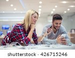 couple shopping a new mobile... | Shutterstock . vector #426715246