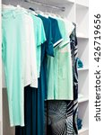 clothes hang on a shelf in a... | Shutterstock . vector #426719656