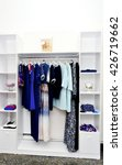 clothes hang on a shelf in a... | Shutterstock . vector #426719662