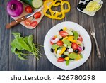 greek salad on wooden... | Shutterstock . vector #426780298