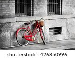 Bright Red Bicycle On The Old...