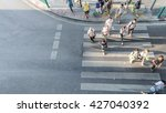 people are moving across the... | Shutterstock . vector #427040392