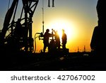 oil field oil workers at work | Shutterstock . vector #427067002