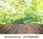close up rustic wood table with ...   Shutterstock . vector #427080685