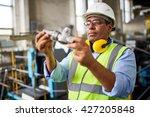 mature technician looking at... | Shutterstock . vector #427205848