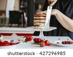 woman carefully icing the cake... | Shutterstock . vector #427296985