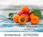fresh apricots on wooden table | Shutterstock . vector #427422502
