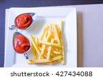 french fries and tomato sauce | Shutterstock . vector #427434088